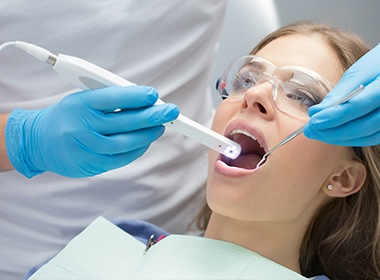 doctor using intraoral camera