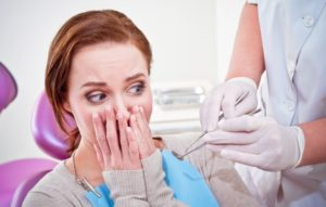 woman fearful at dentist