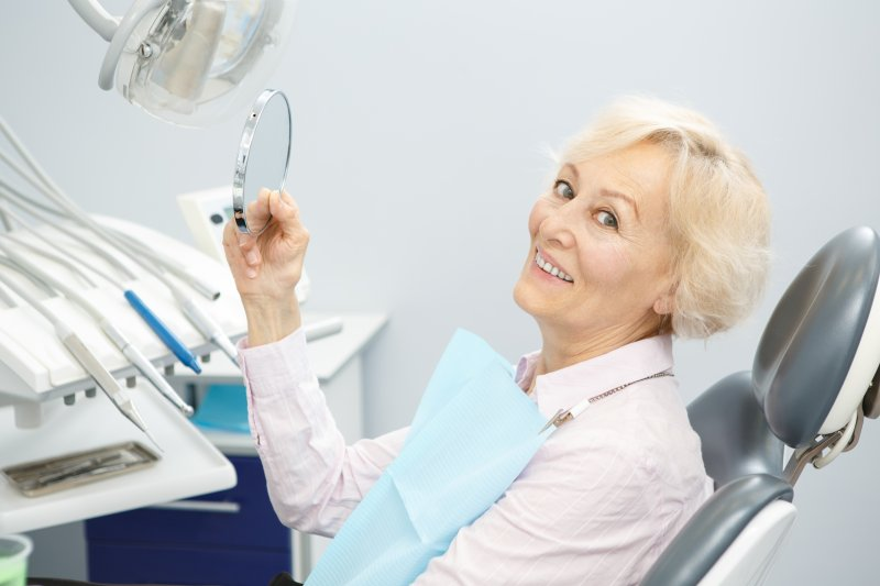 Elderly woman with dental implants
