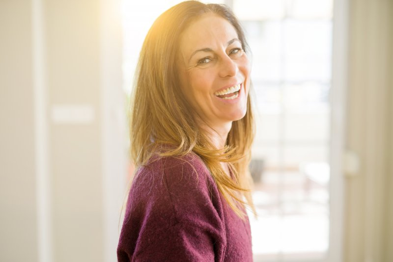 middle aged woman laughing and smiling